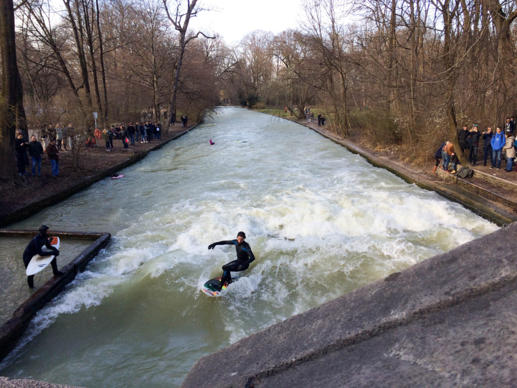 surfers Eisbachwelle Eisback river Munich Bavaria Germany