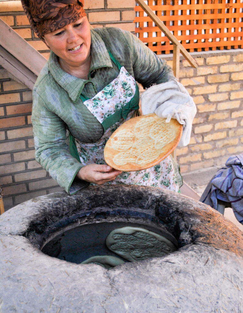 bread making tandoori oven Khiva Uzbekistan Central Asia
